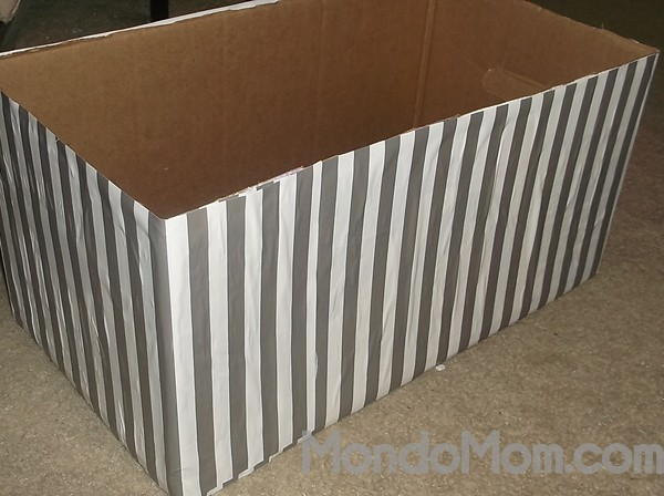 Adhere the wrapping paper to the box