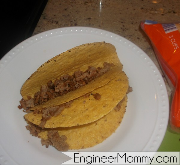 Pour ground turkey in taco shell.