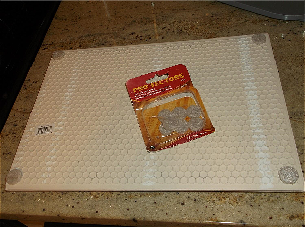 Protective felt circles put on tile