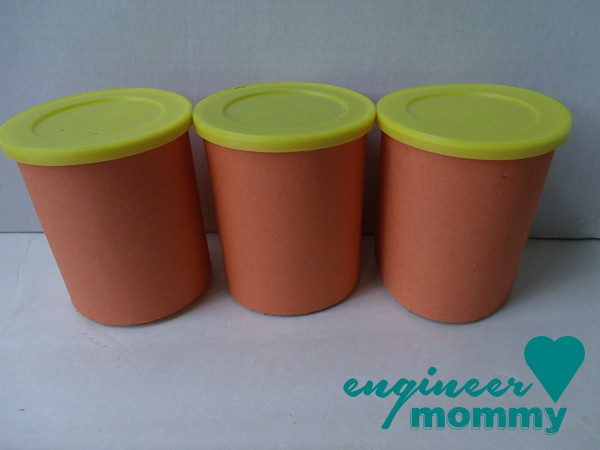 Wrapping the cups in orange construction paper