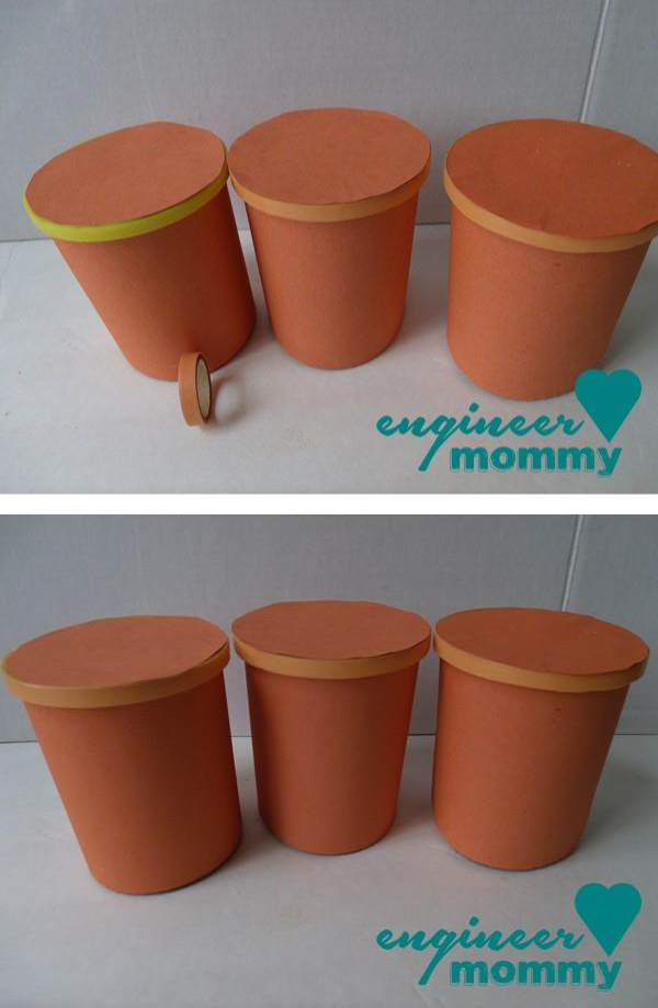 Covering the lids in orange construction paper