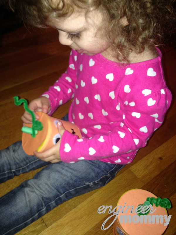 Charlotte admiring one of the Halloween containers