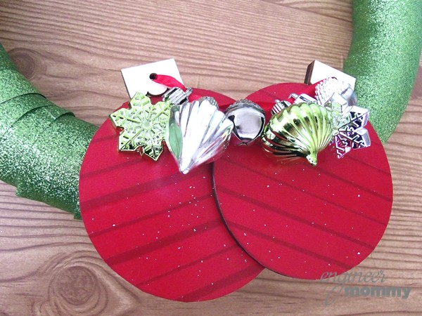 DIY Modern Christmas Wreath: Attaching the Red Ornaments to the Wreath